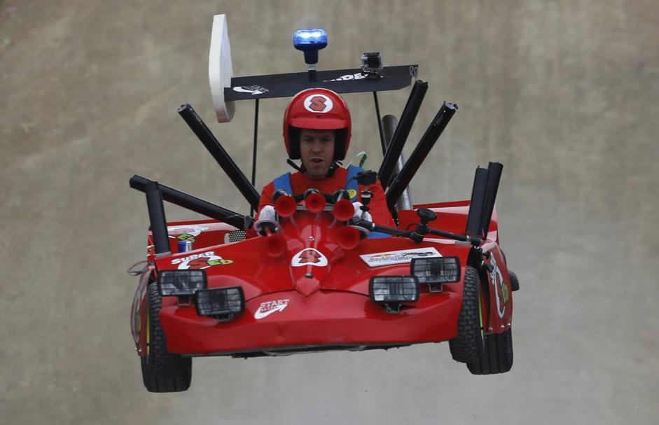 Red Bull Formula One driver Sebastian Vettel takes to the air during a soapbox fun race in Herten