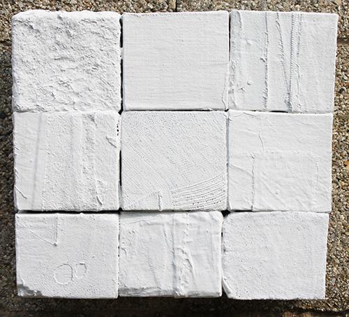 Armando Marrocco-9 cubi vestiti di tela-acrilico su tela e supporto in legno-cm.25x28x9-2010